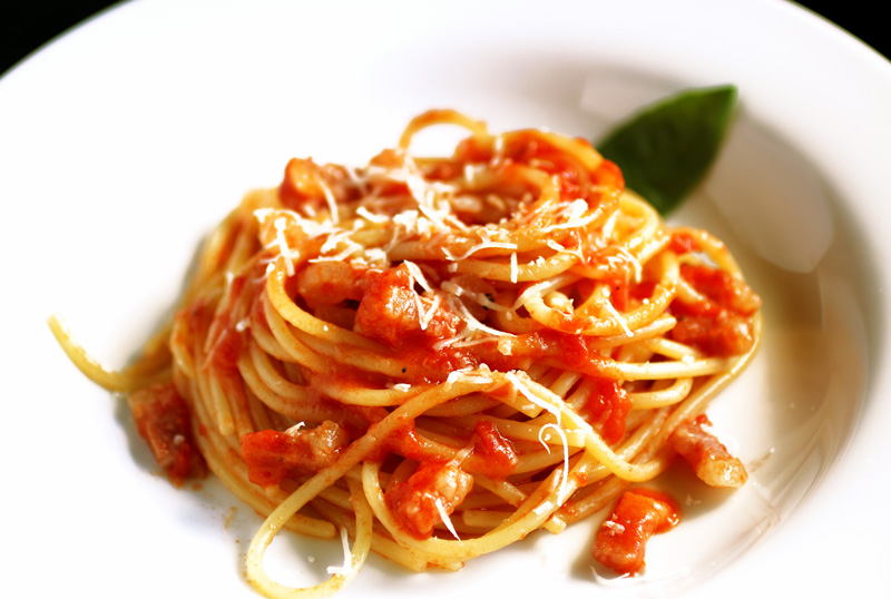 Spaghetti all'Amatriciana - This world reknowned dish hails from the town of Amatrice and was adopted by Rome as one of its signature dishes. It's made with cured pork jowl bacon, tomatoes, chili pepper, pecorino cheese and - of course - spaghetti or bucatini. Simply deliziosa!