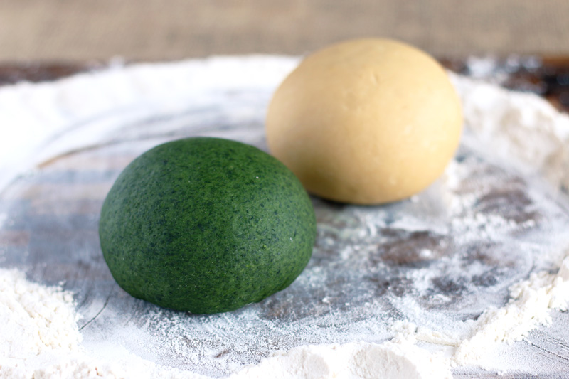 Spinach and egg pasta dough (called straw and hay) is shaped into smooth balls and rest for 30 minutes before rolling.