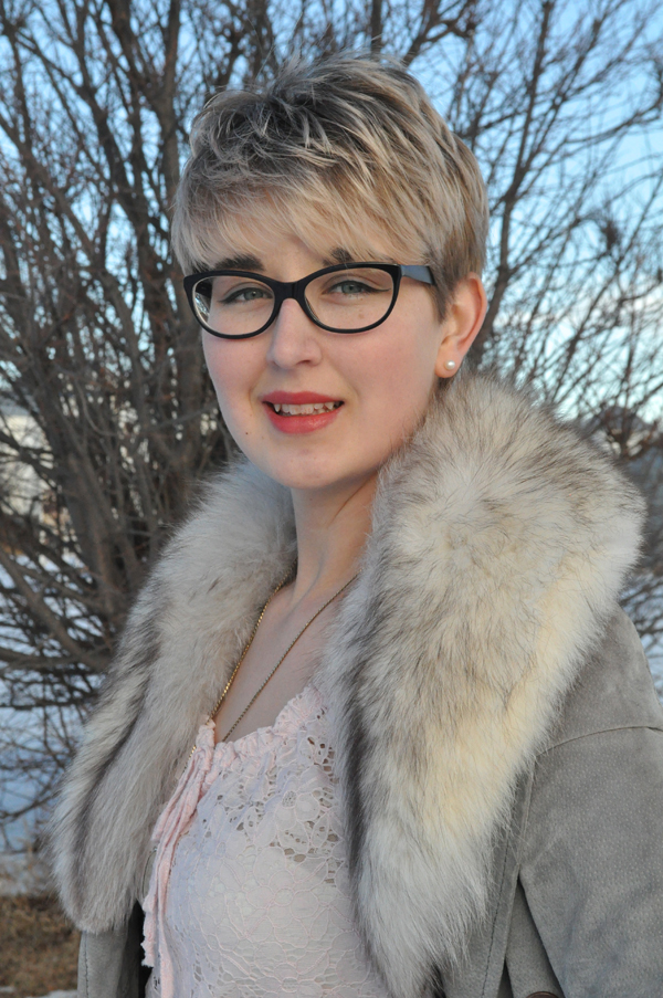 the artyologist- image of pink lace shirt and vintage grey leather coat with a fur collar