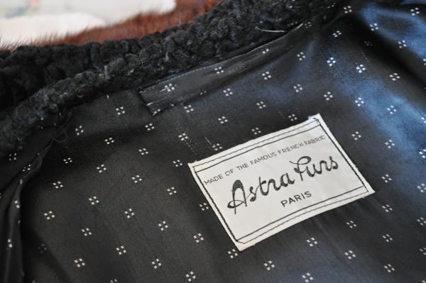 the artyologist- image of Astra Furs Paris label inside vintage astrakhan coat