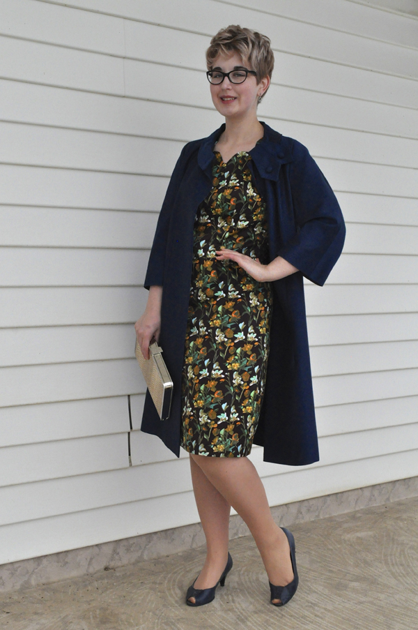 the artyologist- image of a peggy french 1960's swing coat paired with a brown floral dress