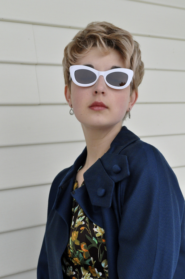 the artyologist- image of a peggy french couture vintage 1960's swing coat paired with white sunglasses