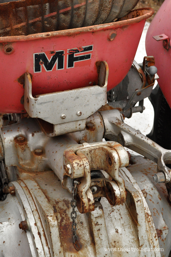 the artyologist- image of back of rusted massey ferguson tractor