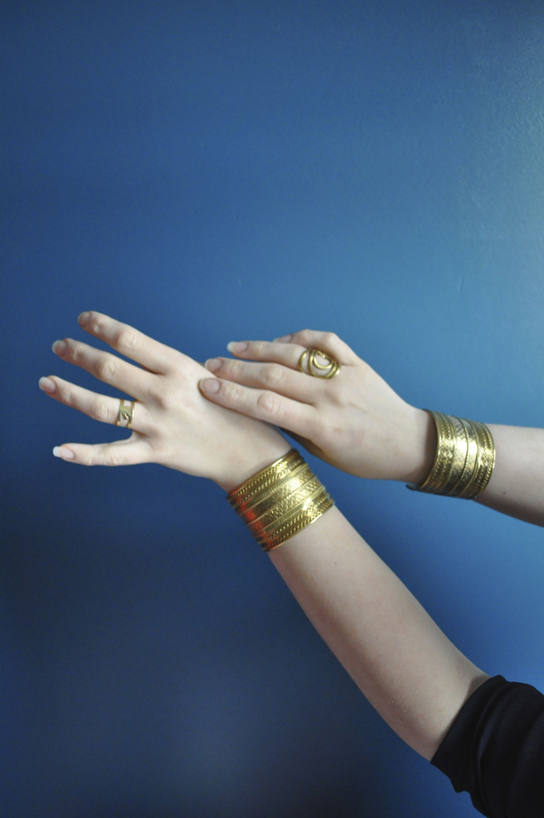 the artyologist- image of hands and brass indian jewelry in the style of vintage vogue 1939 cover
