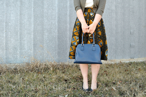 the artyologist- image of vintage styled wax print skirt paired with blue purse