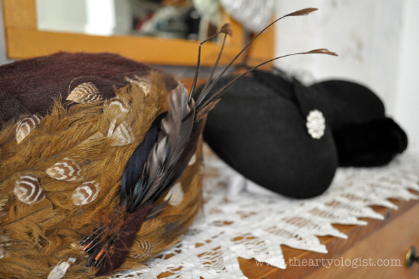 the artyologist image of feathered hat before broken feathers