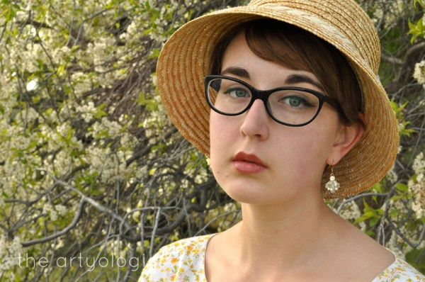 image of floral dress and peach straw hat the artyologist