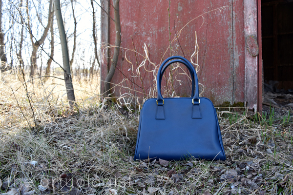 the artyologist image of navy blue structured purse