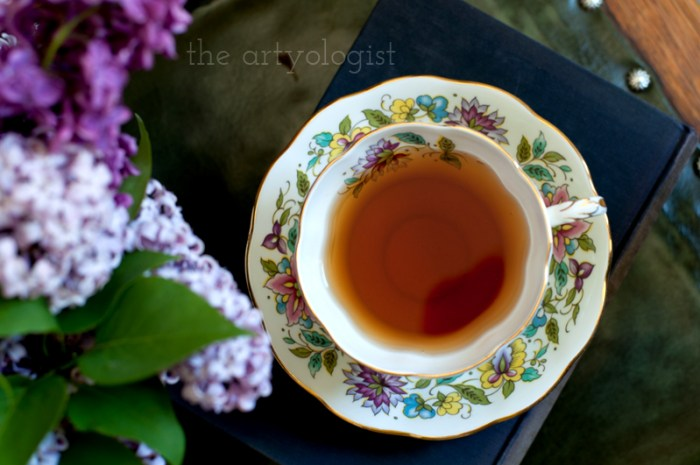 Lilacs to Welcome the First Day of Spring, top view of tea, the artyologist