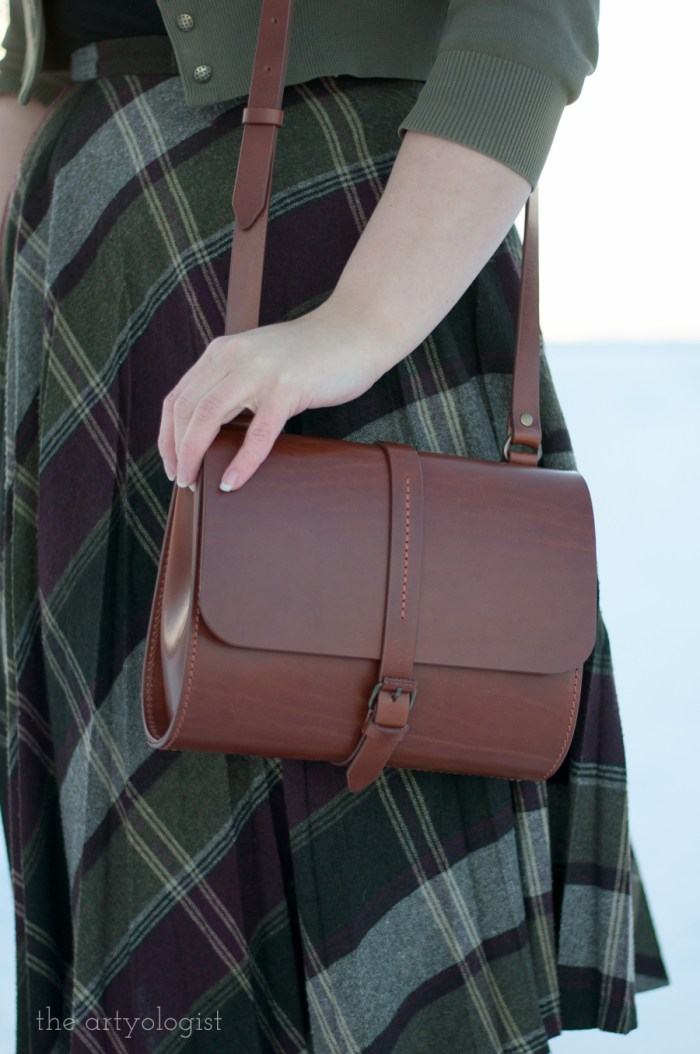 wearing a vintage styled brown leather purse