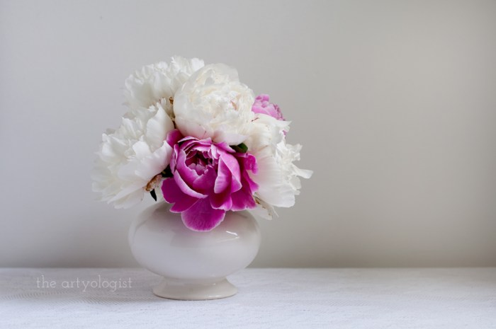 a bouquet of pink and white peonies