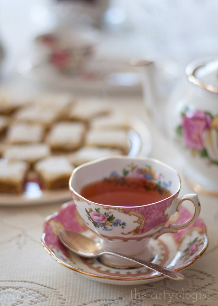 tea in a floral china cup on a lace tablecloth