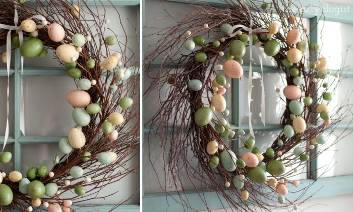a grapevine branch wreath with easter egg decorations on it