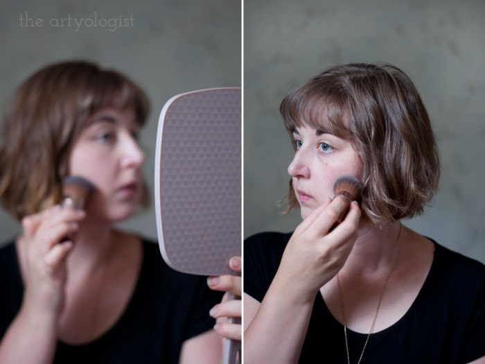 woman powdering her face