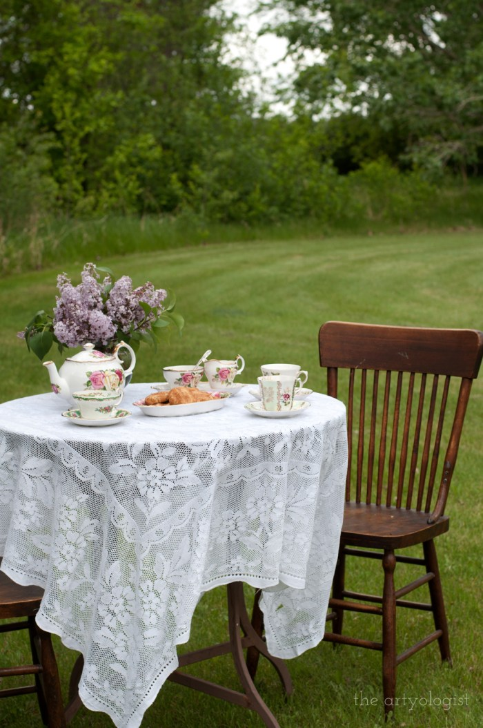 a table set on the lawn for a tea party