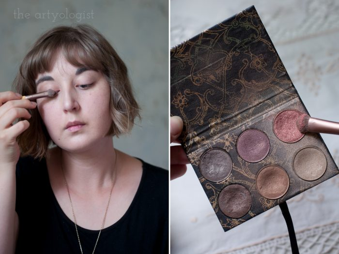 woman putting on eyeshadow