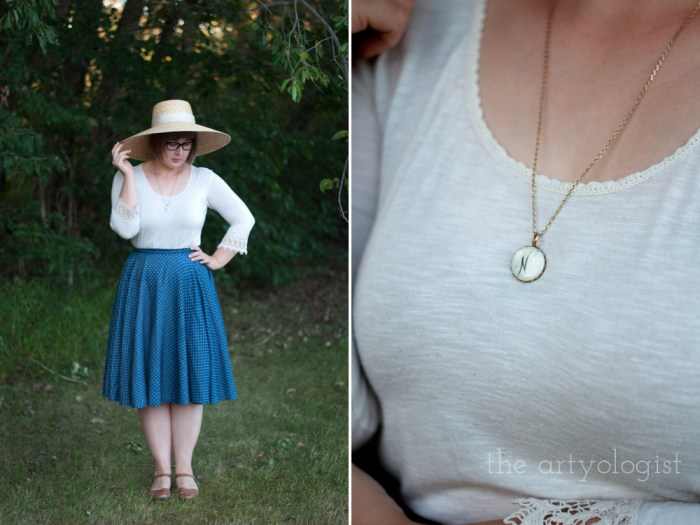 woman wearing a polka dot skirt, cream shirt, straw hat and mother of pearl necklace