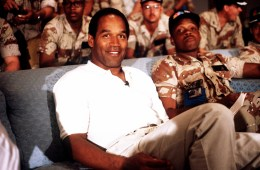 NBC Sports commentator and former professional football player O.J. Simpson sits with a group of servicemen to watch a Thanksgiving Day football game.  Simpson is visiting U.S. troops who are in the region for Operation Desert Shield.