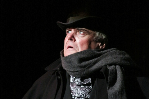 """Kevin Loomis as Ebenezer Scrooge in a scene from Titan Theatre Company's """"A Christmas Carol"""" (Lloyd Mulvey)"""