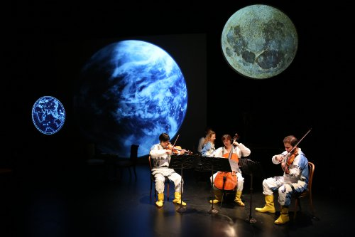 """Ensemble for the Romantic Century's violinist Sean Lee, pianist Eve Wolf, cellist Jiyoung Lee and violist Andrew Gonzalez in a scene from """"Jules Verne: From the Earth to the Moon"""" (Photo credit: Joan Marcus)"""