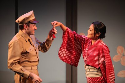 "Morgan McCann as Ace Gruver and Ya Han Chang as Hana-Ogi in a scene from ""Sayonara, The Musical"" (Photo credit: John Quincy Lee)"