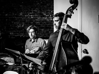 """Brian Chase on drums and James Ilgenfritz on bass at Experiments in Opera: """"The Travel Agency Is On Fire: Burroughs Cuts Up the Great Bards"""" (Photo credit: Peter Gannushkin)"""