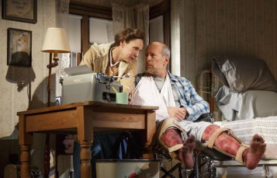 "Laurie Metcalf as Annie Wilkes and Bruce Willis as Paul Sheldon in a scene from ""Misery"" at the Broadhurst Theatre (Photo credit: Joan Marcus)"