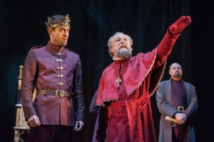 "Alex Hassell as Henry and Jim Hooper as the Archbishop of Canterbury in a scene from the RSC's ""Henry V"" (Photo credit: Stephanie Berger)"
