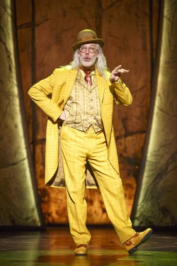 "Terrence Mann as The Man in the Yellow Suit in a scene from ""Tuck Everlasting"" (Photo credit: Joan Marcus)"
