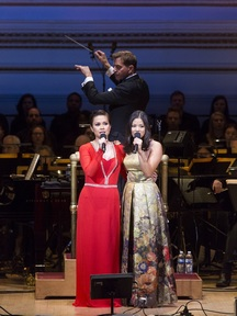 "Lea Solonga and Eva Noblezada, two ""Kims"" from ""Miss Saigon,"" with maestro Steven Reineke podium in The New York Pops' 33rd Birthday Gala entitled "" Do You Hear the People Sing"" (Photo credit: Richard Termine)"