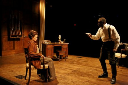 """Maggie Lacey as Laura and John Douglas Thompson as The Captain in a scene from Strindberg's """"The Father"""" (Photo credit: Gerry Goodstein)"""