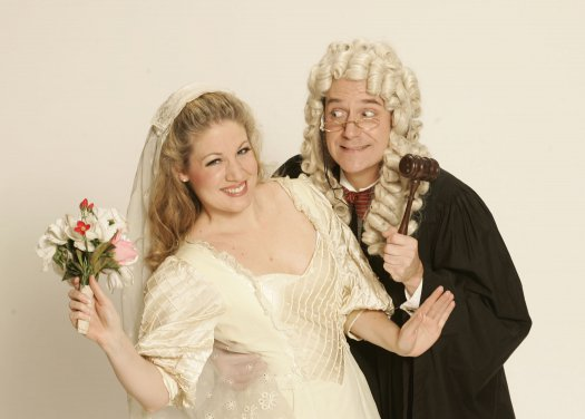 """Laurelyn Watson Chase and Stephen Quint in a scene from Gilbert & Sullivan's """"Trial by Jury"""" (Photo credit: Carol Rosegg)"""