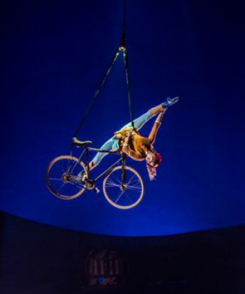 "France's Anne Weissbecker in the ""Aerial Bike"" act in in Cirque du Soleil's ""Kurios: Cabinet of Curiosities"" (Photo credit: Martin Girard/shoot studio.ca; costumes: Philippe Guillotel)"