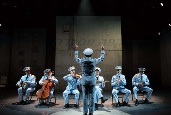 "Ari'el Stachel, David Garo Yellin, George Abud, Tony Shalhoub, Harvey Valdes, Sam Sadigursky and Alok Tewari in a scene from ""The Band's Visit"" (Photo credit: Ahron H. Foster)"