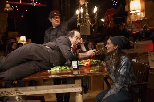 """Geoff Sobelle (on table) in a scene from """"The Object Lesson"""" at New York Theatre Workshop (Photo credit: Joan Marcus)"""