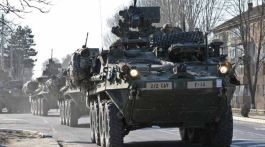 2nd Cavalry Regiment Strykers leave the front gate of an air base in Romania for a tactical road march to the Smardan Training Area in support of Operation Atlantic Resolve.