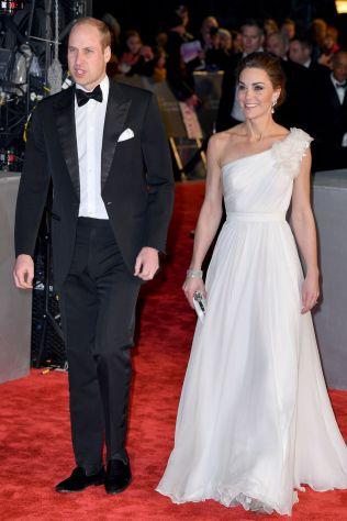 Il Duca di Cambridge e la Duchessa di Cambridge in Alexander McQueen e sandali Jimmy Choo ai BAFTAs 2019, London
