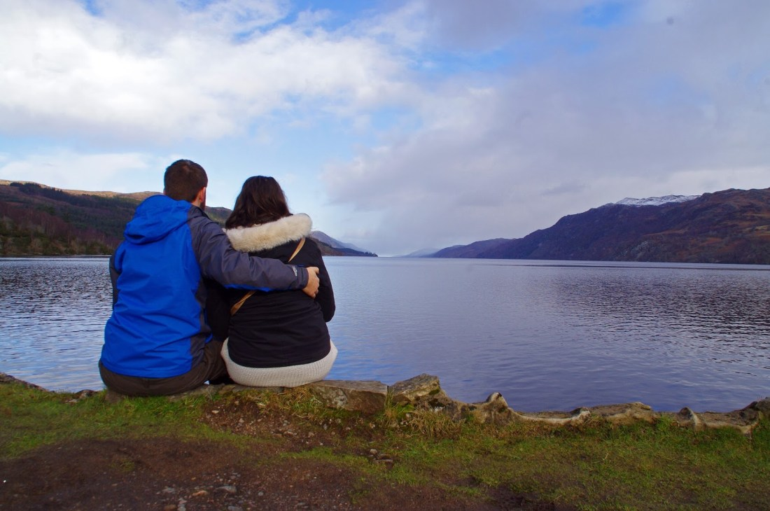 Simone and Dan sitting on shore of Loch Ness