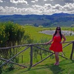 Girl in Red Dress in Tuscany Winery
