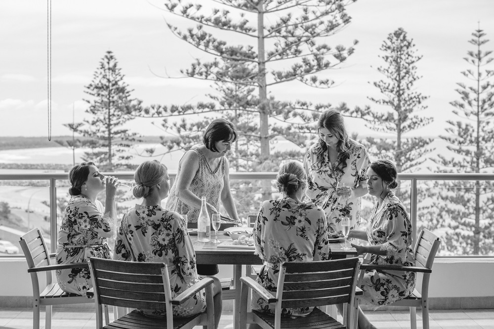 Bridal party having lunch on balcony