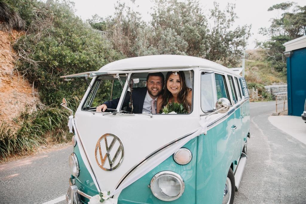 Bride and Groom in VW Kombi Wedding Car
