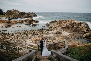 Bride and Groom kissing at Little Bay Port Macquarie