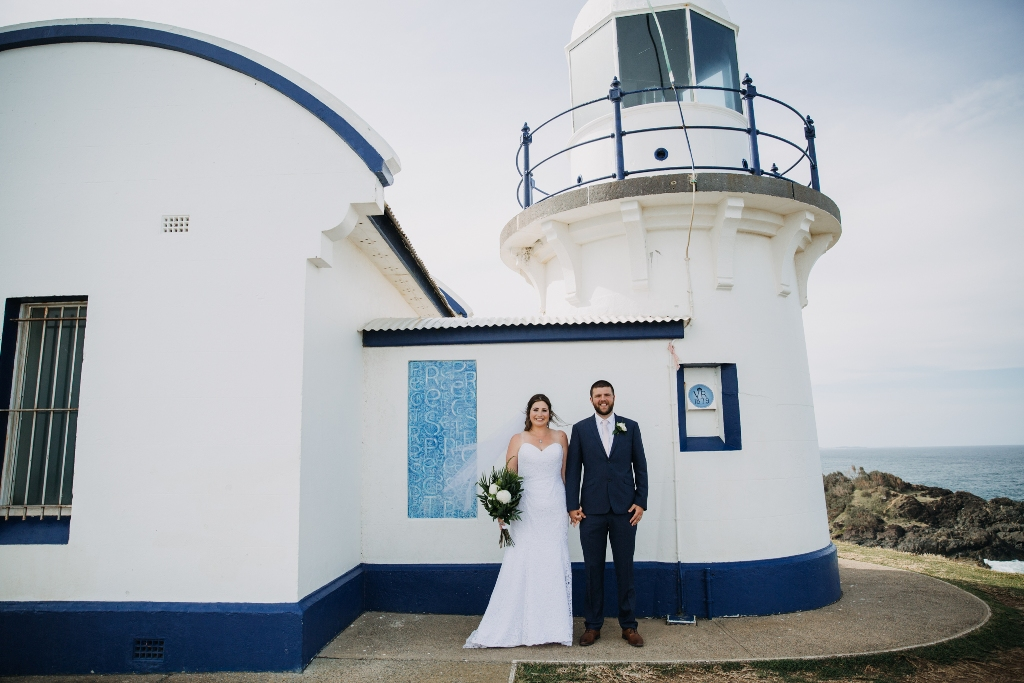 Bride and Groom standing in front of Tacking Point Lighthouse Port Macquarie