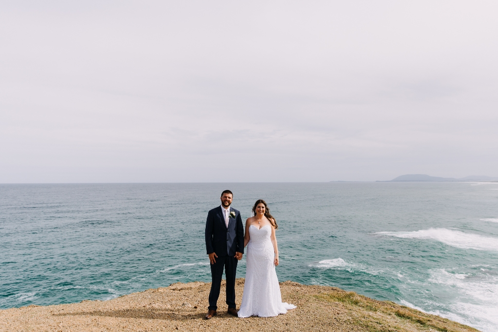 Bride and Groom standing on lookout in Port Macquarie