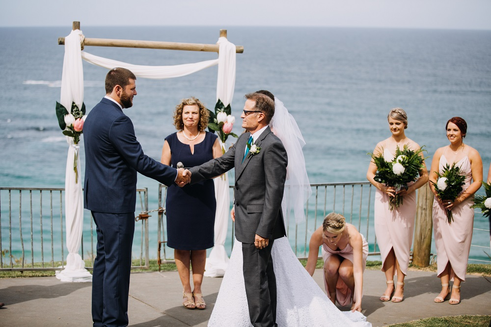 Father shaking Groom's hand