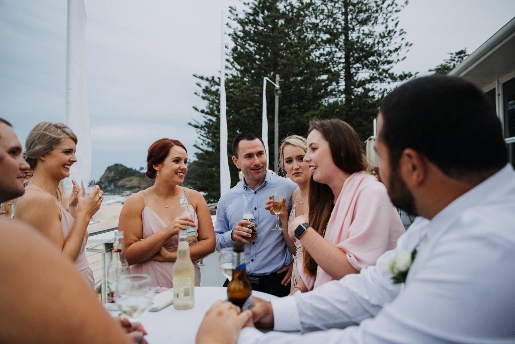 Friends at wedding on balcony