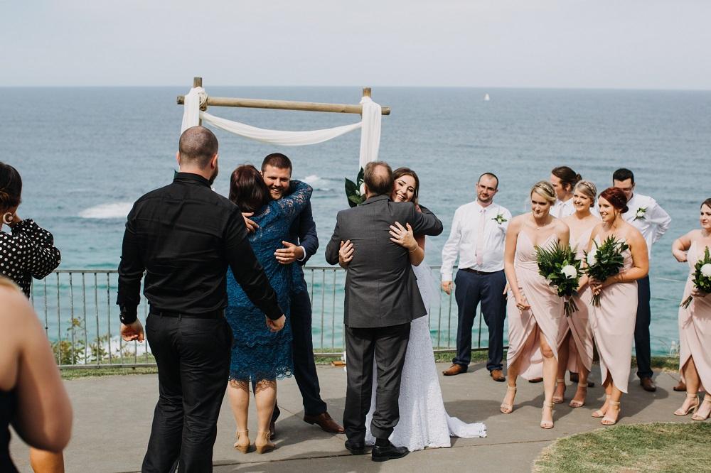 Hugging parents after wedding