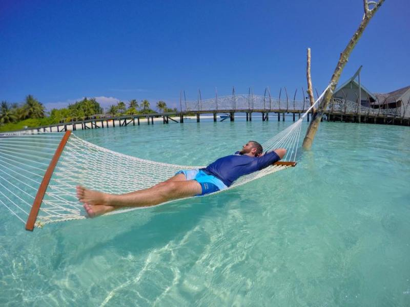 Male in Water Hammock in Maldives