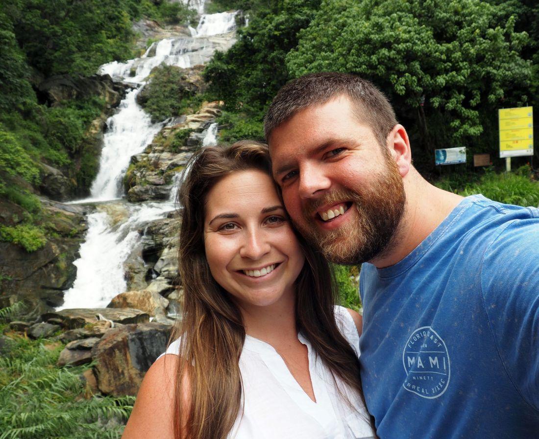 Couple in front of waterfall in Sri Lanka