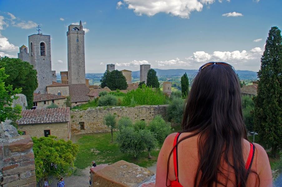 Girl looking at towers of San Gimignano Tuscany
